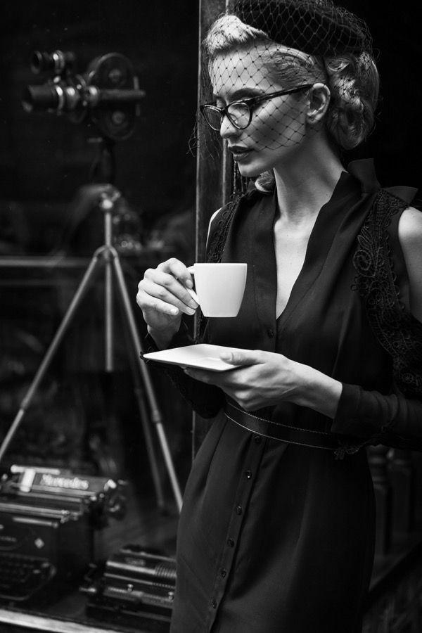 Elegant blond retro woman in black dress
