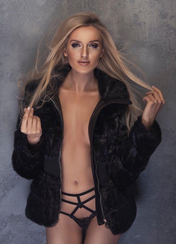 Beauty blonde woman in black fur