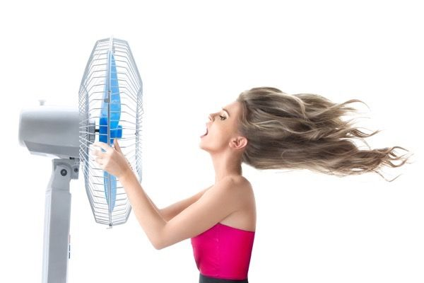 Young woman with cooler fan
