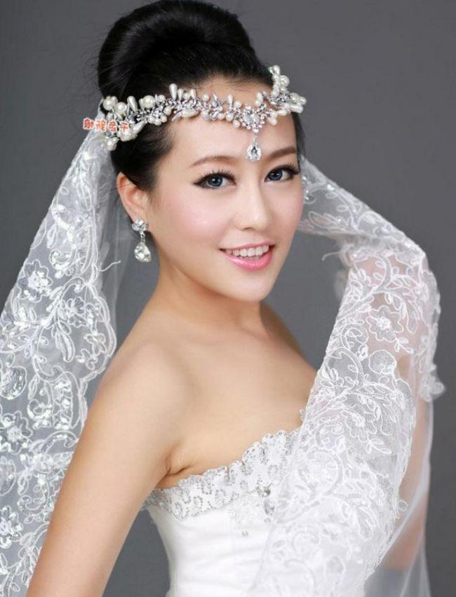 свадебные прически пучок прически из собранных волос с живыми цветами прически 2014 фото лучшие свадебные стилисты